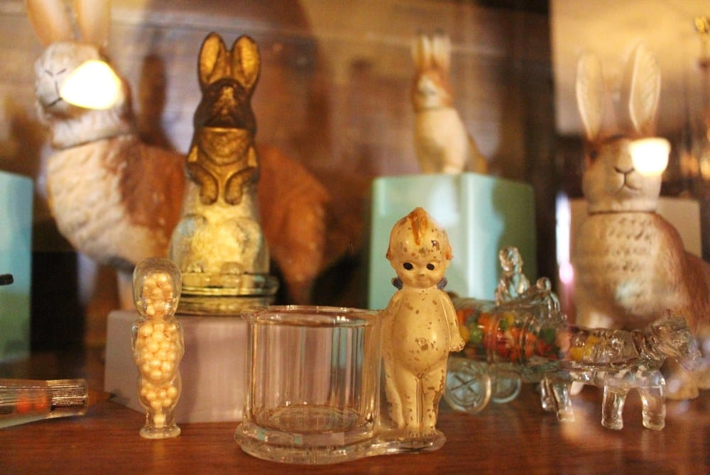 The Cedar Falls Historical Society's Cabinet of Curiosities includes antique candy dishes!
