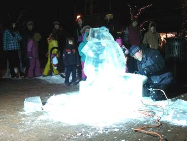 Ice Sculptor at Baby It's Cold Outside | downtown Cedar Falls, Iowa